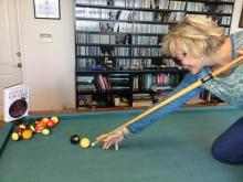 Catherine playing pool